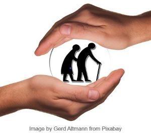 schützende HAnd über alte Menschen